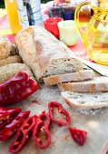 Sliced white bread and red pepper on table