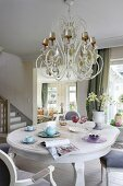 Dining area with opulent chandelier above dining table