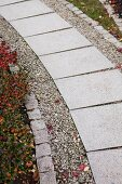 Garden path with stone flags edged in gravel