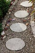 Round stone flags in gravel path