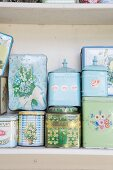 Various vintage floral tins on shelf
