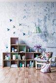 DIY cardboard shelf with a Scandinavian armchair in front