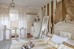 Elegant bedroom with ensuite bathroom decorated by white balustrade and lace curtains