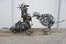 Two wire bird sculptures