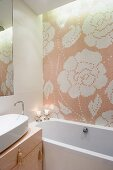 Floral tiled mosaic above bathtub and washstand with tassels on drawer handles