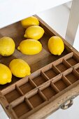 Lemons in vintage wooden tray