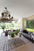 Elegant outdoor lounge area on roofed terrace
