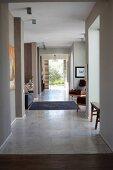 Open-plan corridor area with stone-flagged floor