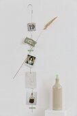 Mementos stuck on unwound wire coat hanger