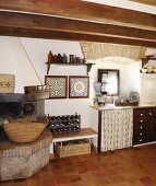 Mediterranean kitchen-dining room with open-plan fireplace and frame, traditional tile samples