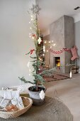 Simple Scandinavian interior with fireplace in concrete chimney breast and Christmas decorations