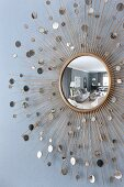 Round mirror reflecting elegant interior