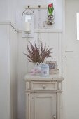 Vintage-style spring arrangement on old bedside cabinet against wainscoting