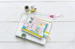 Notebook and bookmark decorated with colourful washi tape