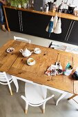 Dining table with rustic surface