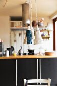 Three pendant lamps with retro lampshades above dining table