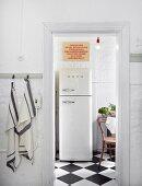 View of retro-style fridge-freezer through open door