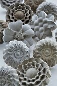 Concrete furniture knobs in various floral shapes
