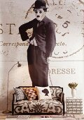 Wallpaper with Charlie Chaplin motif, sofa with patterned upholstery and retro standard lamp