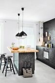 Island counter with chipboard worksurface and bar stools in industrial-style, fitted kitchen
