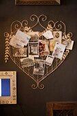 Vintage metal heart used as pin board