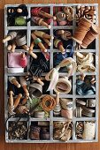 Vintage-style wooden case of organised ribbons