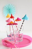 Hand-crafted paper umbrellas as decorations for party drinks