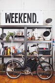 Vintage bicycle in front of metal shelving and large sign