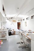 Cantilever chairs and Tripp Trapp highchair in open-plan interior of houseboat