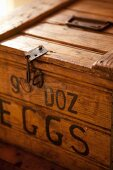 Detail of wooden crate with simple catch and black stencilled label