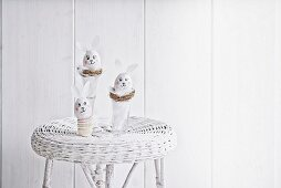 Blown eggs made into Easter bunnies in white surroundings
