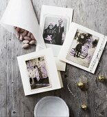 Christmas cards made from vintage family photos painted with festive motifs