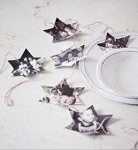 Garland of stars cut out of vintage family photos on Christmas dinner table