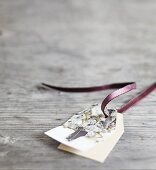 Christmas gift tag made from vintage family photo decorated with gold pen