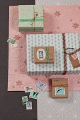 Festive gift-wrapping ideas: wrapping paper, postage stamps and ribbons