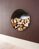 Firewood store in round niche in wall