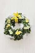 Easter floral wreath decorated with bunnies & feathers