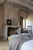 Antique marble fireplace and coffered ceiling in bedroom