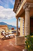 Roof terrace with terracotta floor and porch on columns (Villa Cimbrone Hotel)