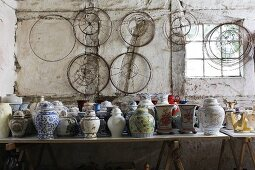 Collection of Chinese vases and lampshade frames in old workshop