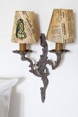 Vintage sconce lamp with newspaper lampshades and butterfly decoration