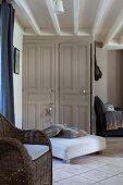Two old panelled doors in living room with exposed ceiling beams