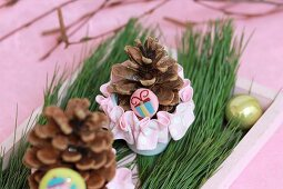 Festive table arrangement with pine cones on wooden tray