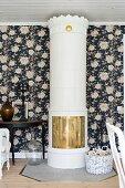 Swedish tiled stove against floral wallpaper