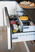 Open kitchen drawer with hidden interior drawer and practical dividers