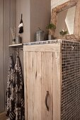 Rustic bathroom cabinet with wooden door and mosaic tiles