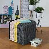 Knitting with a crochet needle: stool with knooked cover