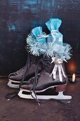 A pair of ice skates filled with presents