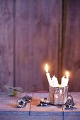 A Christmas tree candle holder and white Christmas tree candles