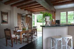 Counter, barstools and dining set with carved chairs in old country house